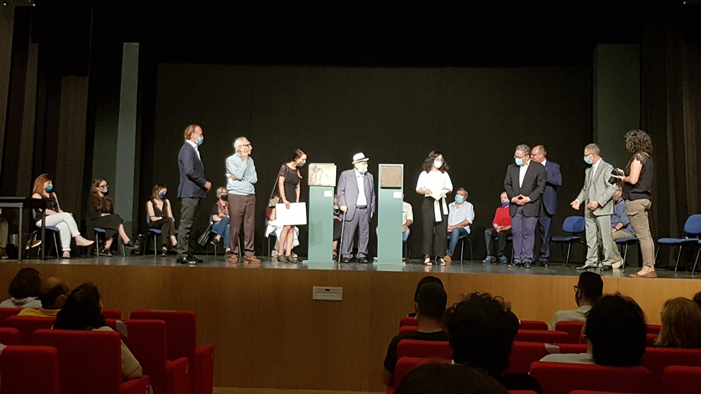 on stage during the delivery of the Ronzat prize